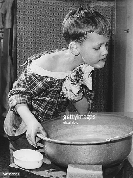 Germany Bavaria boy is washing his neck 1950s