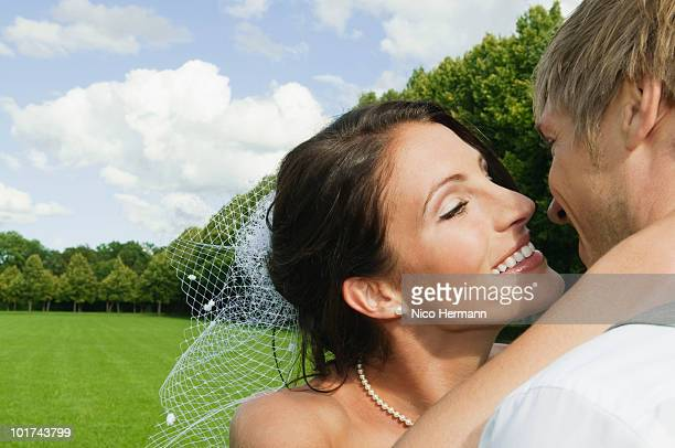 Germany, Bavaria, Bride and groom kissing, close-up
