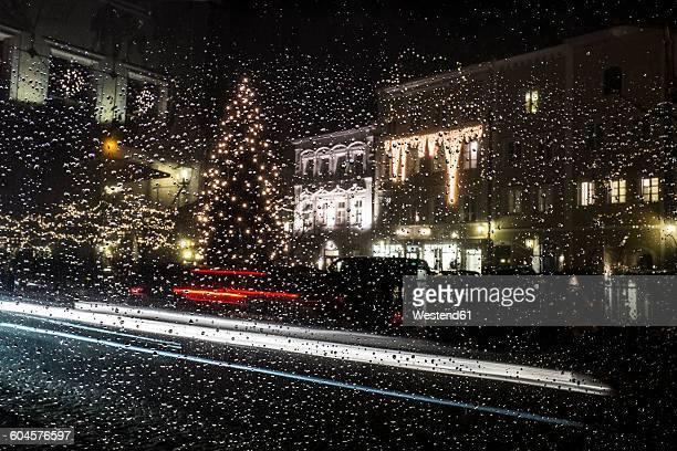 Germany, Bavaria, Burghausen, Christmas tree, car window with rain drops