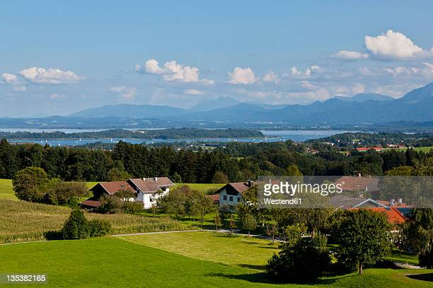 Germany, Bavaria, Chiemgau Alps, Herrenchiemsee, Chiemsee, View of village with island and freshwater lake in background