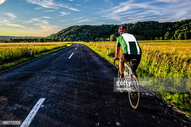 Germany, Bavaria, Chiemgau, racing biker on tour