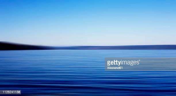 germany, bavaria, chiemsee, lake in the evening - horizont über wasser stock-fotos und bilder