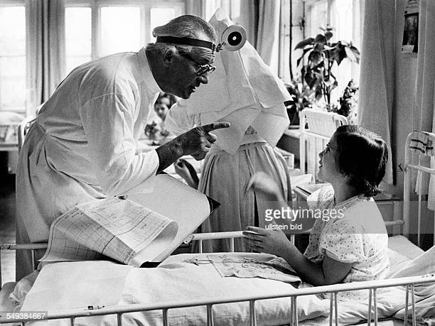 children's hospital Doctor visiting a sick child in the fifties