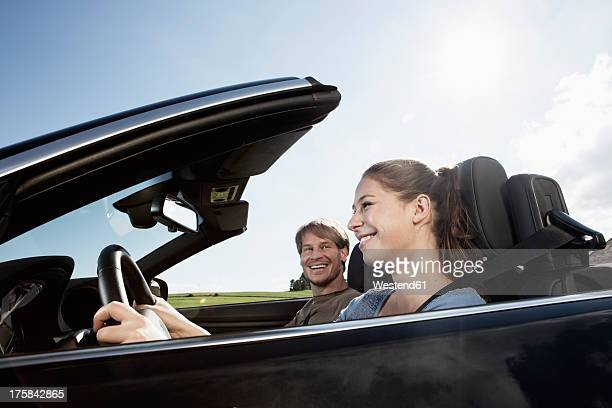 Germany, Bavaria, Couple in car, smiling