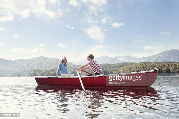 germany, bavaria, couple in rowing boat, smiling - small boat stock pictures, royalty-free photos & images