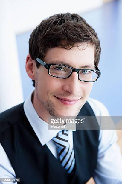 Germany, Bavaria, Diessen am Ammersee, Close up of businessman, smiling, portrait