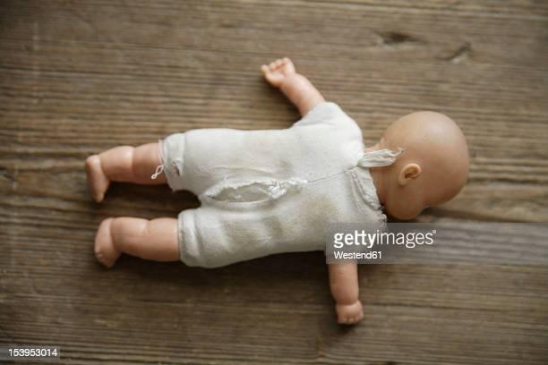 Germany, Bavaria, Doll on wooden floor