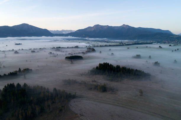Germany, Bavaria, Drone view of Loisach-Kochelsee-Moore bogs shrouded in morning fog