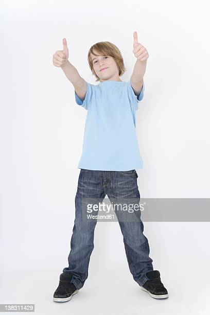 Germany, Bavaria, Ebenhausen, Boy standing against white background, smiling