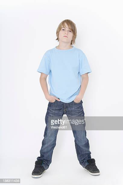 Germany, Bavaria, Ebenhausen, Boy standing against white background, portrait