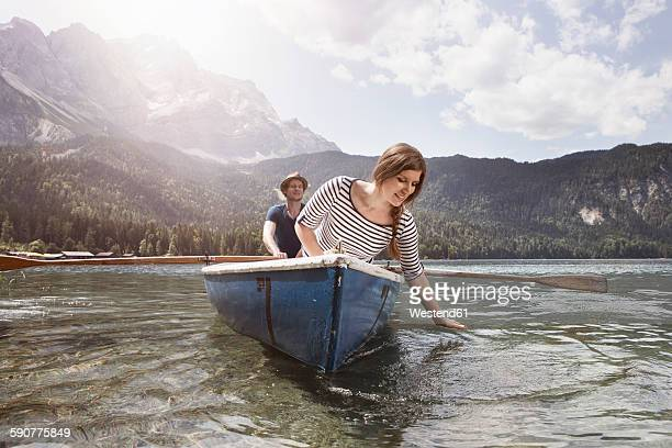 Germany, Bavaria, Eibsee, couple in rowing boat on the lake