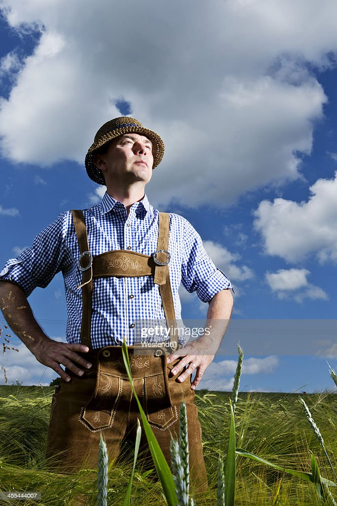 Germany, Bavaria, Farmer standing in field and looking away : Photo