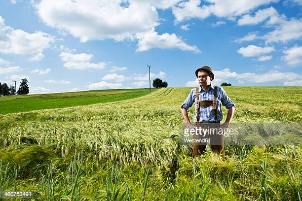Germany, Bavaria, Farmer standing in field