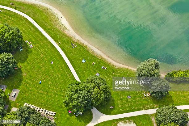 Germany, Bavaria, Feldkirchen, aerial view of people at lakeshore