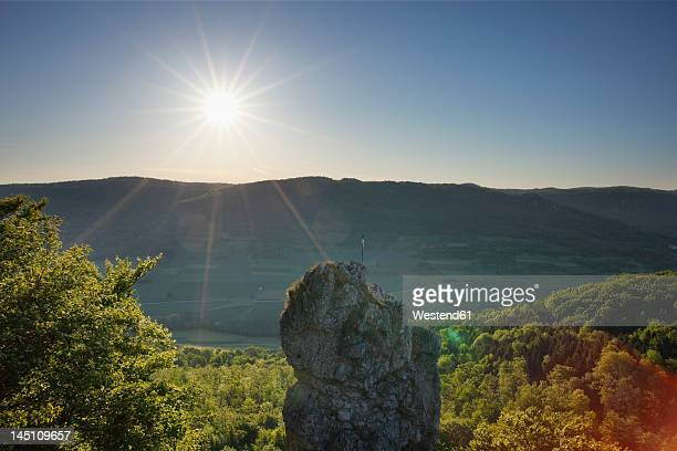 Germany, Bavaria, Franconia, Franconian Switzerland, View of mountain with sun