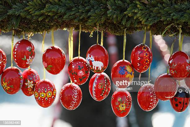 Germany, Bavaria, Franconia, Upper Franconia, Franconian Switzerland, Bieberbach, Easter eggs hanging at easter well, close up
