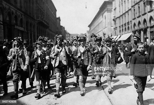 Germany Bavaria Free State Munich Bavarian Soviet Republic A Werdenfelser Freikorps unit in traditional garb marching through the streets of Munich...