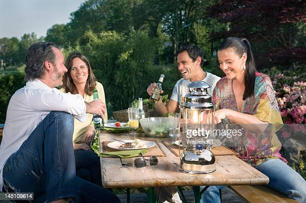 germany, bavaria, friends enjoying barbecue food and drinks - barbecue social gathering stock pictures, royalty-free photos & images