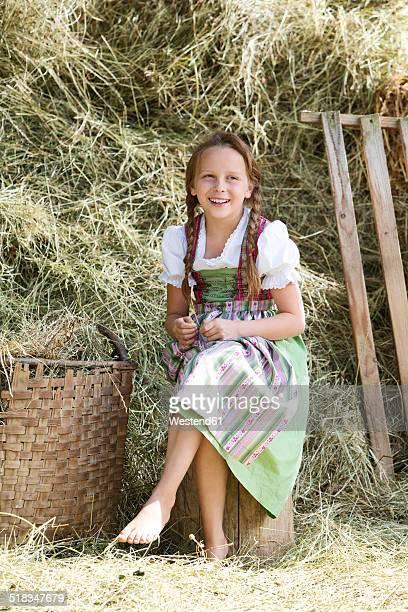 Germany, Bavaria, Girl in traditional dirndl