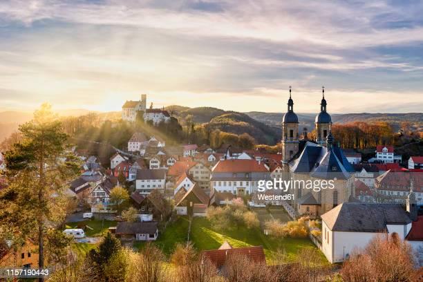 germany, bavaria, goessweinstein, view over basilica and castle - beieren stockfoto's en -beelden