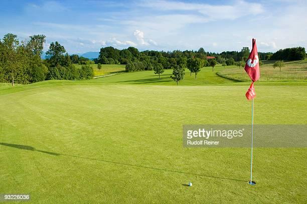 germany, bavaria, golf green with flag - golfplatz green stock-fotos und bilder