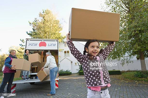 Germany, Bavaria, Grobenzell, Family with cardboard box for moving house