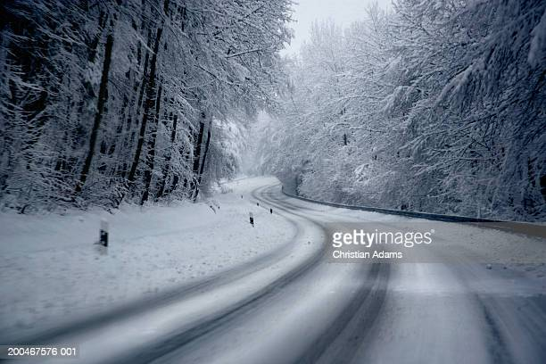 Germany, Bavaria, Hohenschaftlarn, road and winter landscape