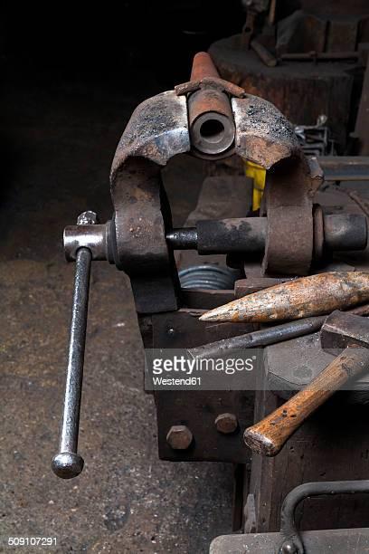 Germany, Bavaria, Josefsthal, bench vice, hammer and anvil beak at historic blacksmith's shop
