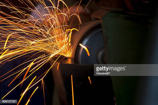 Germany, Bavaria, Josefsthal, sparkles at grinder in historic blacksmith's shop