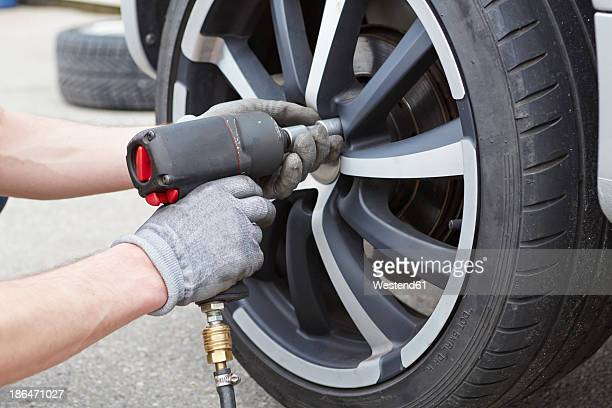 Germany, Bavaria, Kaufbeuren, Mature man changing car tire
