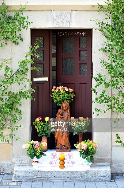 Germany Bavaria Kronach Feast of Corpus Christi decorated windows and doors