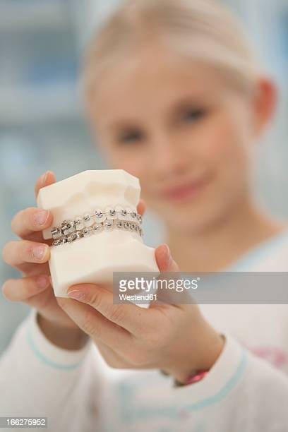young girls with dentures