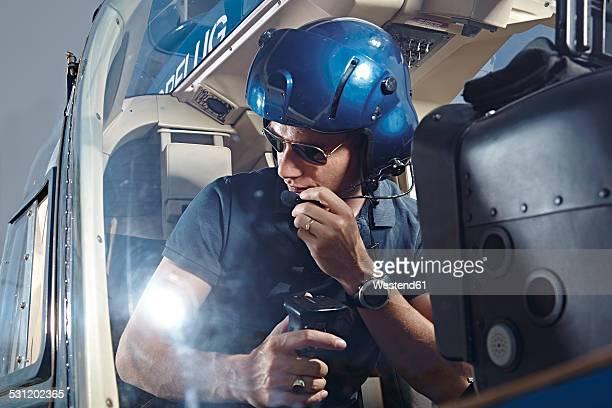 Germany, Bavaria, Landshut, Helicopter pilot in cockpit