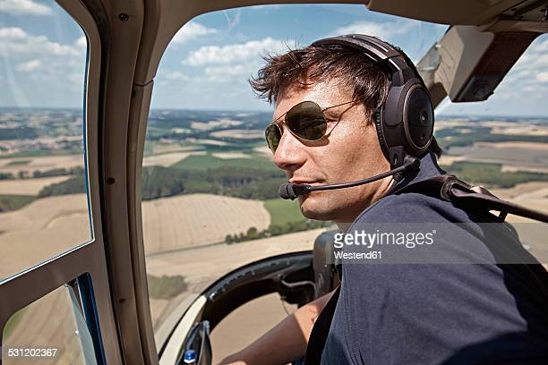 germany, bavaria, landshut, helicopter pilot in cockpit - inside helicopter stock pictures, royalty-free photos & images