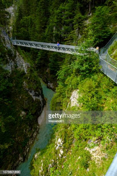 germany, bavaria, leutasch gorge near mittenwald, woman on bridge - mittenwald stock pictures, royalty-free photos & images