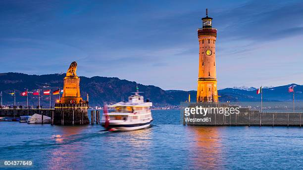 Germany, Bavaria, Lindau, Lake Constance, Harbour entrance with bavarian lion, ship in the evening