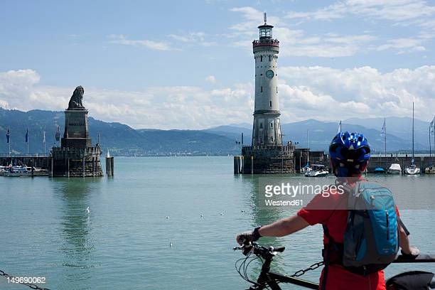 germany, bavaria ,lindau, lake constance, mature man looking at harbour - bodensee stock pictures, royalty-free photos & images