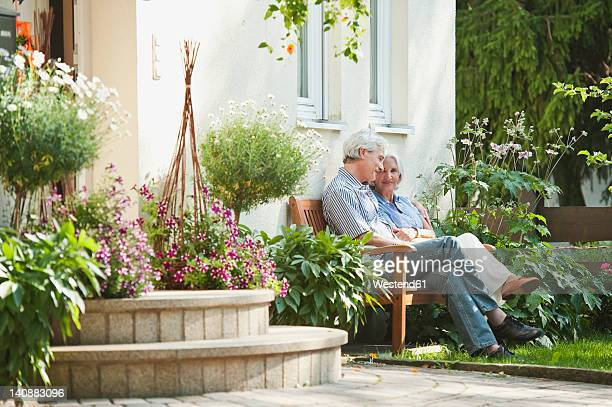 Germany, Bavaria, Man and woman sitting in garden