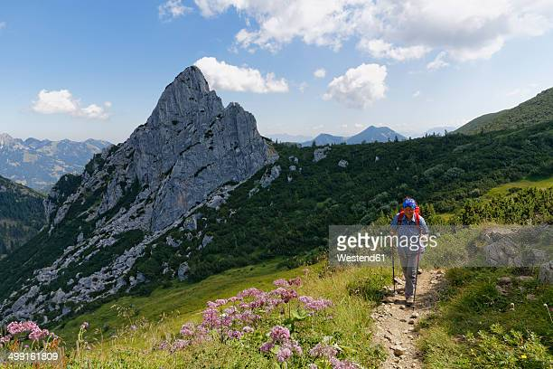 Germany, Bavaria, Mangfall Mountains, Hiker at Ruchenkoepfe near Bayrischzell