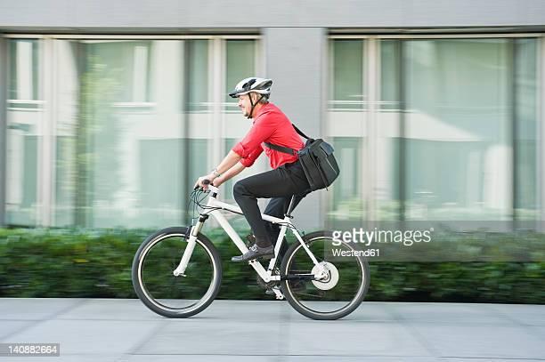 Germany, Bavaria, Mature man riding bicycle
