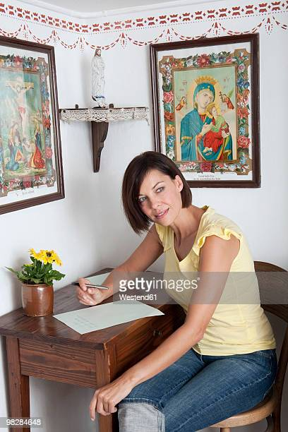 Germany, Bavaria, Mature woman writing letter