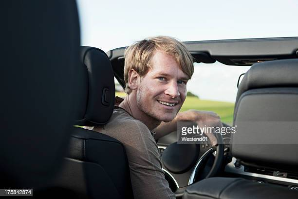 Germany, Bavaria, Mid adult man in car