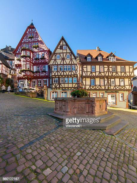 Germany, Bavaria, Miltenberg, half-timbered houses on the market square with fountain