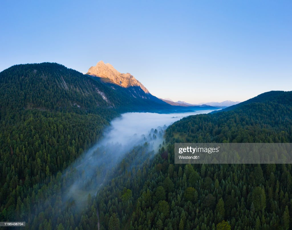 Germany, Bavaria, Mittenwald, Aerial view of Ferchensee lake shrouded in morning fog : Foto de stock