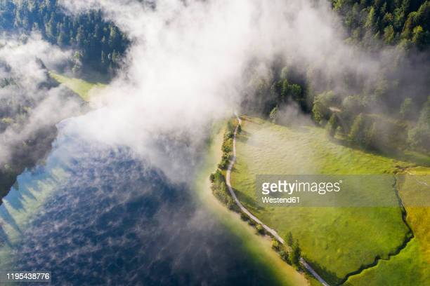 germany, bavaria, mittenwald, aerial view of fog floating over ferchensee lake - mittenwald fotografías e imágenes de stock