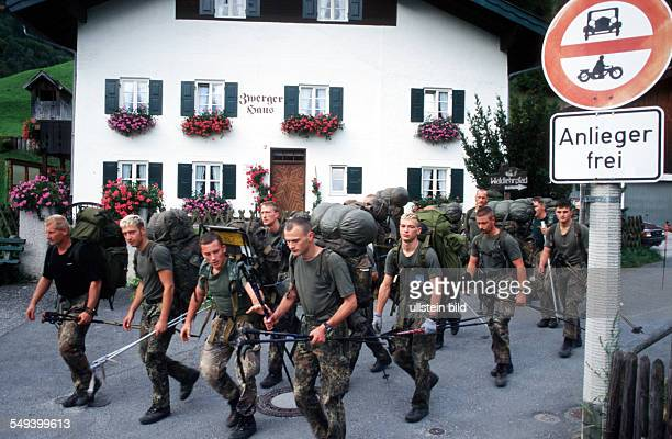 Germany, Bavaria, Mittenwald: Mountain soldiers on the snow mountain at the endurance march.