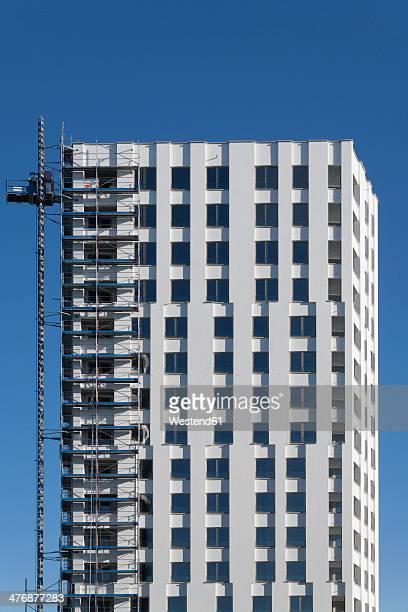 Germany, Bavaria, Munich, apartment tower under construction