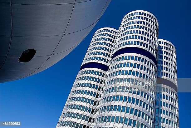 Germany Bavaria Munich BMW Headquarters exterior Angled part view of the BMW Tower which stands 101 meters tall and mimics the shape of tires