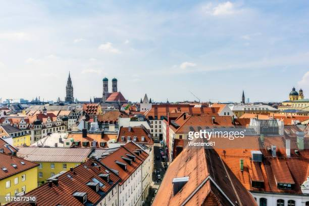 germany, bavaria, munich, city center and cathedral of our lady - münchen stock-fotos und bilder