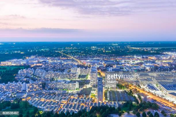 Germany, Bavaria, Munich, cityscape near Olympic Park at night, drone photography